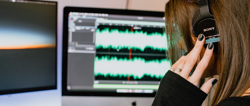 Woman editing the podcast on a Mac